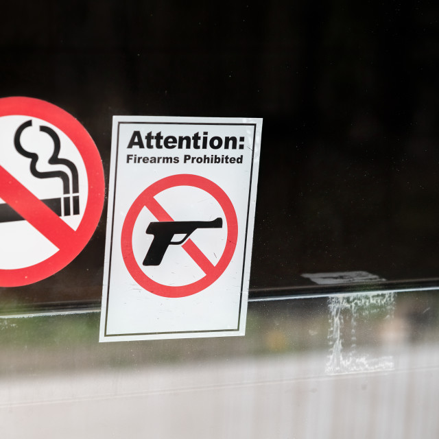 """""""Firearms prohibited and no smoke signal"""" stock image"""