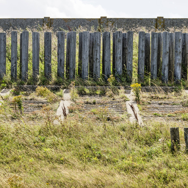 """Weathered coastal defense structures"" stock image"