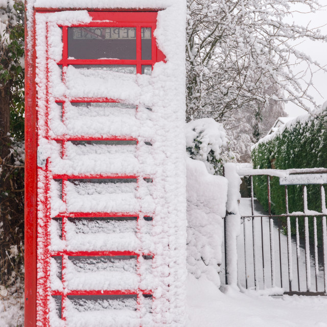 """""""Snow covered phonebooth"""" stock image"""