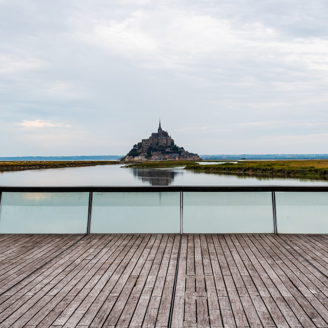 """View of Mont Saint Michel against sky"" stock image"