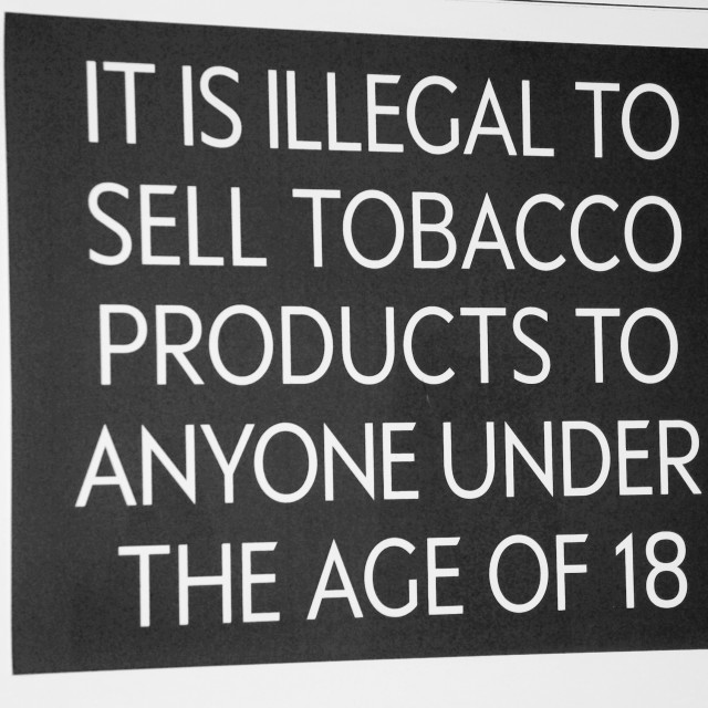 """""""Tobacco products age restriction sign"""" stock image"""