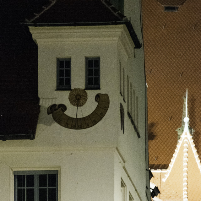 """Smily face sundial at night"" stock image"
