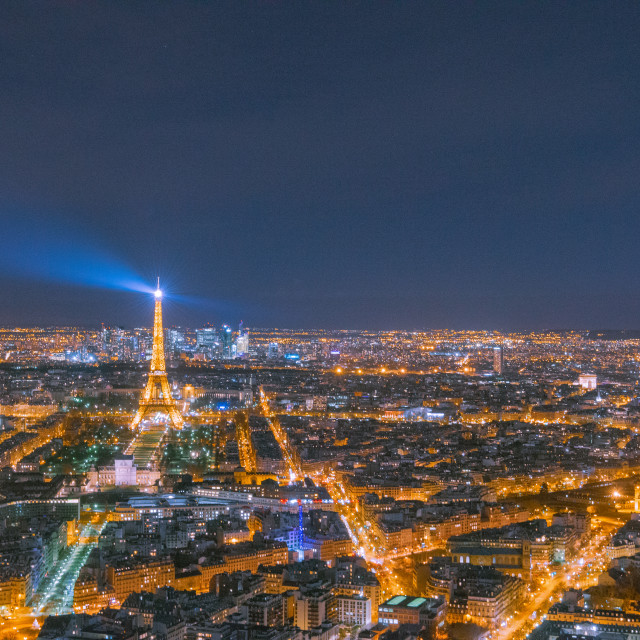 """Eiffel tower and the street lights of Paris from the 56th floor"" stock image"