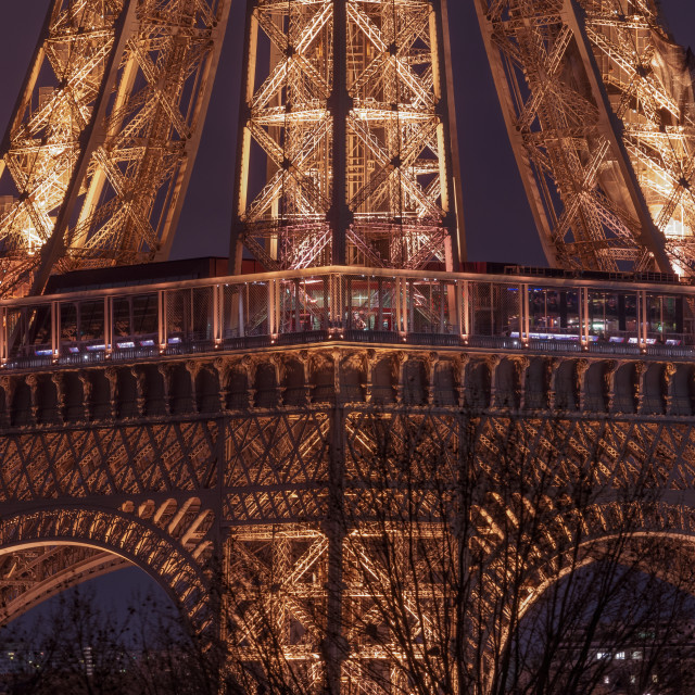 """Intricate architecture of the Eiffel Tower at night // Paris, Fr"" stock image"