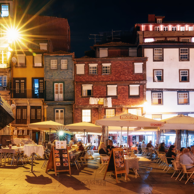 """""""Nightlife on the crowded promenade of the Douro River with cafes and restaurants in Porto"""" stock image"""