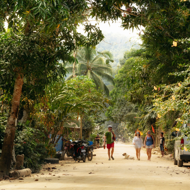 """Street with dirt road in traditional Philippine village"" stock image"