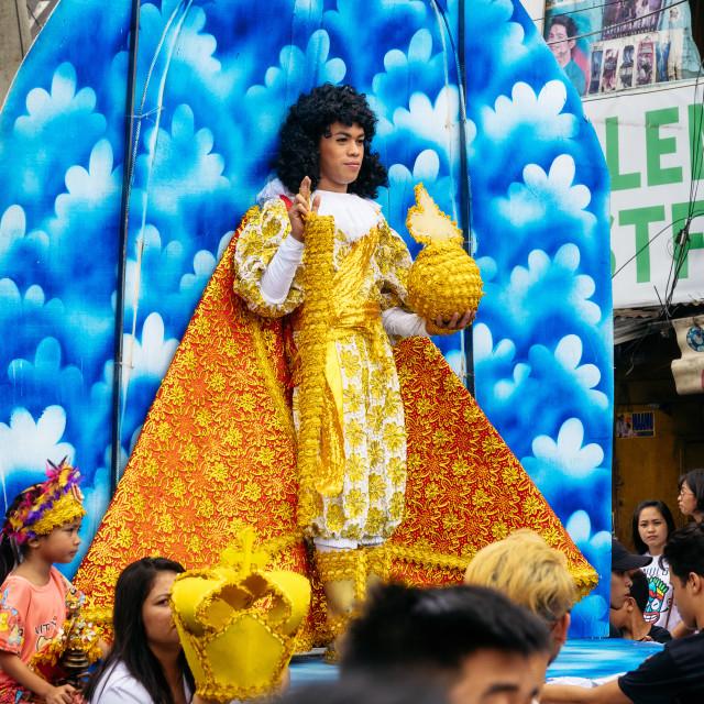 """Living man looks like Santo Nino at the Sinulog Festival."" stock image"
