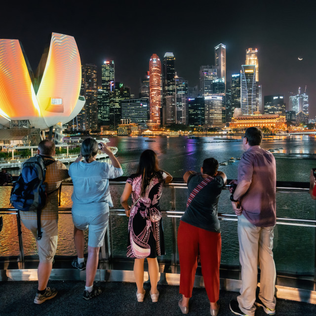 """People watch illumintaed cityscape of Singapore"" stock image"