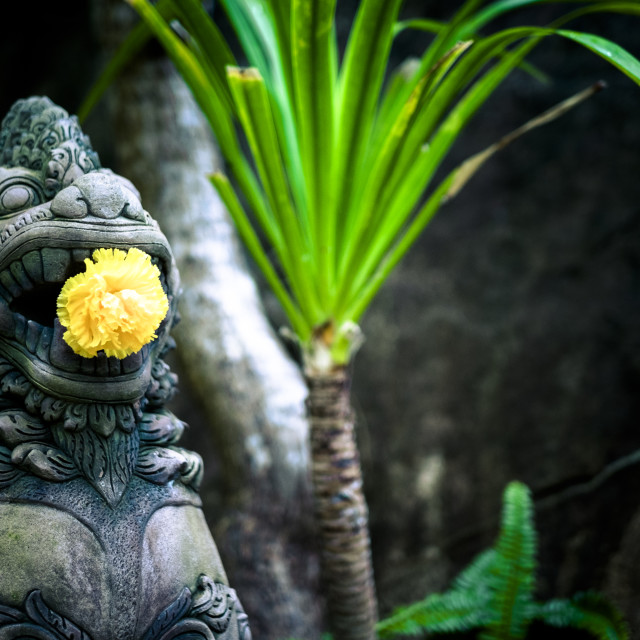 """""""Thai Statue with Flower"""" stock image"""