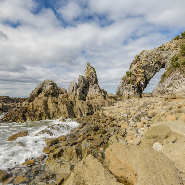"""Natural archway at Langs Beach // Northland, New Zealand"" stock image"