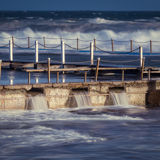 """Overflow at North Narrabeen rock pool // Sydney, Australia"" stock image"