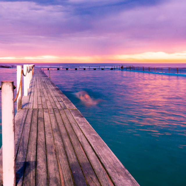 """Sunrise over to North Narrabeen rock pool // Sydney, Australia"" stock image"