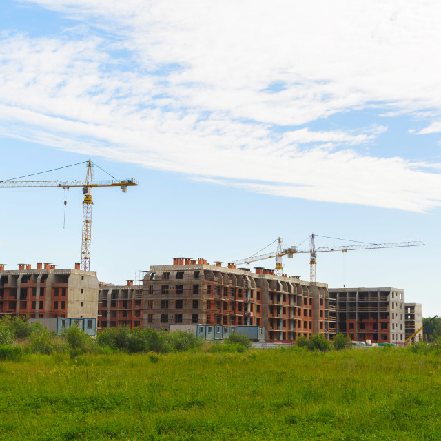 """""""Crane and building under construction against blue sky"""" stock image"""