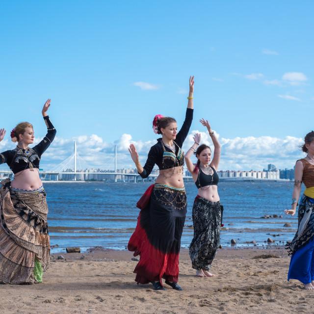 """Saint-Petersburg, Russia. August 24, 2019: Women dancers in oriental costumes on the shore."" stock image"