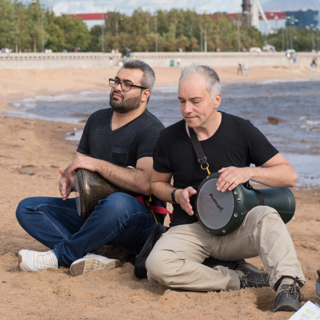 """""""Saint-Petersburg, Russia. August 24, 2019: Street musicians play drums on the beach."""" stock image"""