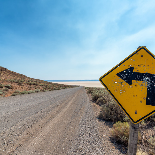 """Left Turn Sign in the Alvord Desert"" stock image"