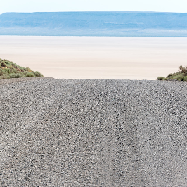 """Gravel Road and Alvord Desert"" stock image"