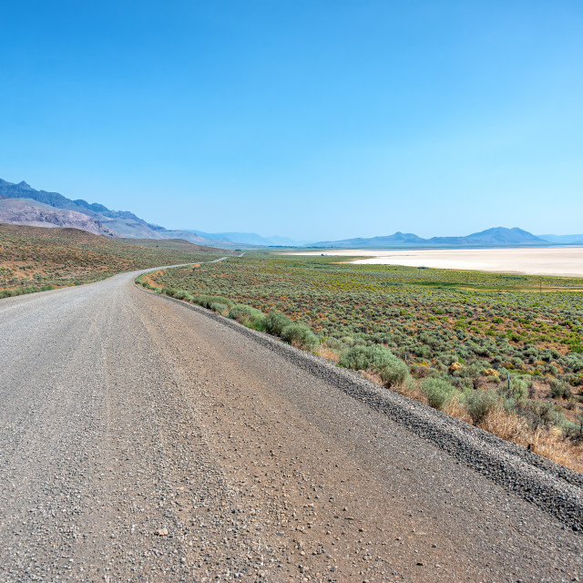 """Gravel Road and Alvord Desert View"" stock image"