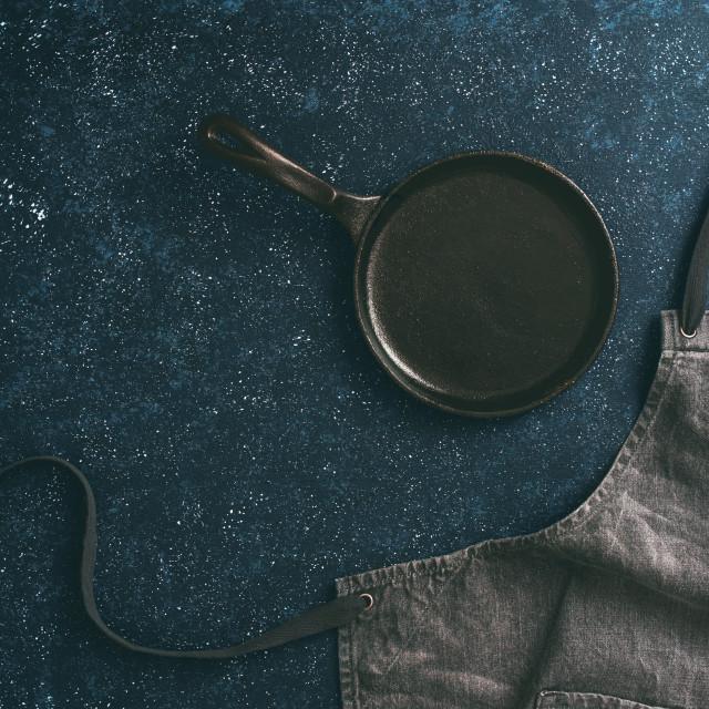 """denim cotton apron on dark background, copy space"" stock image"