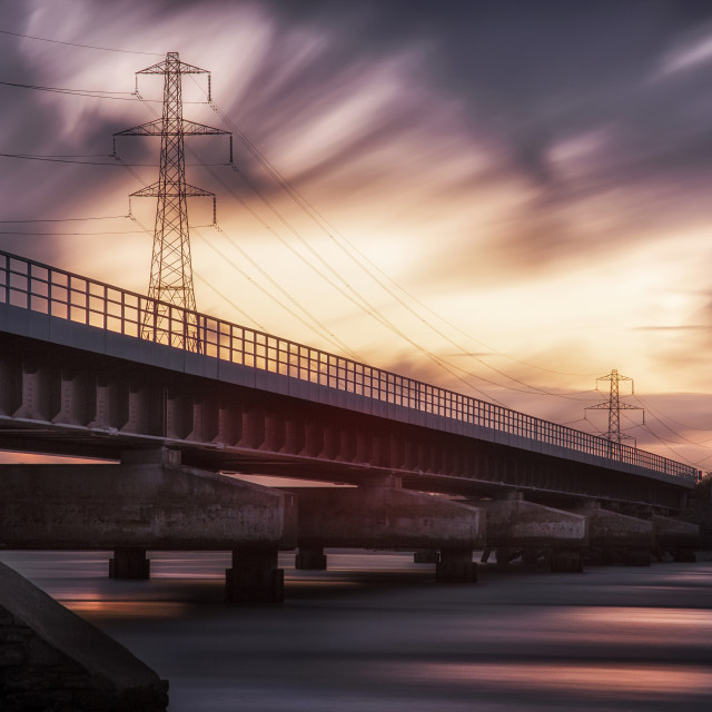 """Loughor estuary rail bridge sunset"" stock image"