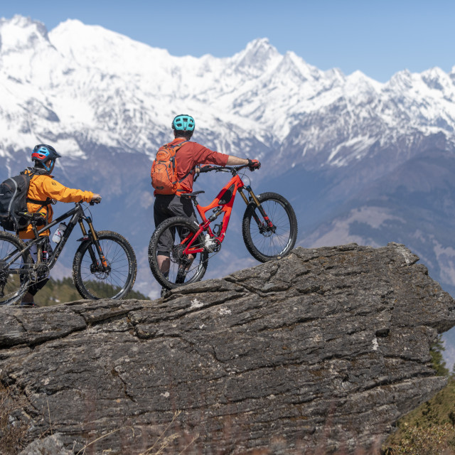 """""""Mountain biking in the Himalayas with views of the Langtang mountain range in..."""" stock image"""