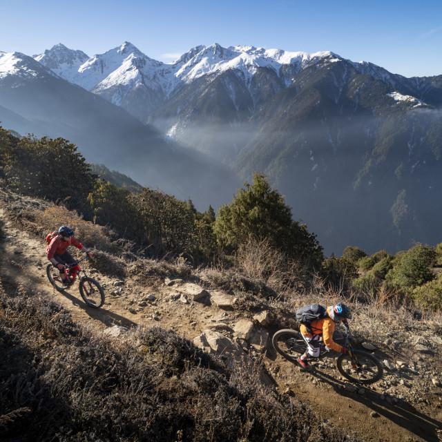 """Mountain biking along a Enduro style single track trail in the Nepal..."" stock image"