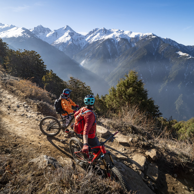 """""""Mountain bikers take a rest on an Enduro style single track trail in the..."""" stock image"""