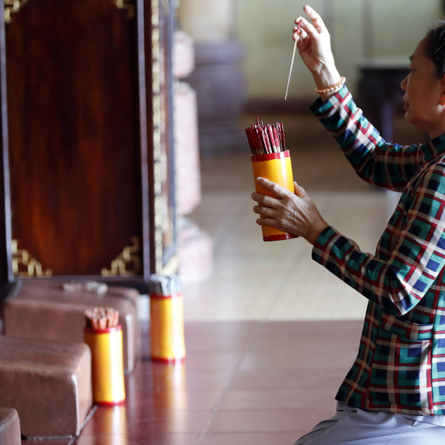 """Woman at temple. Buddhist divination. Pho Da temple. Vung Tau. Vietnam."" stock image"