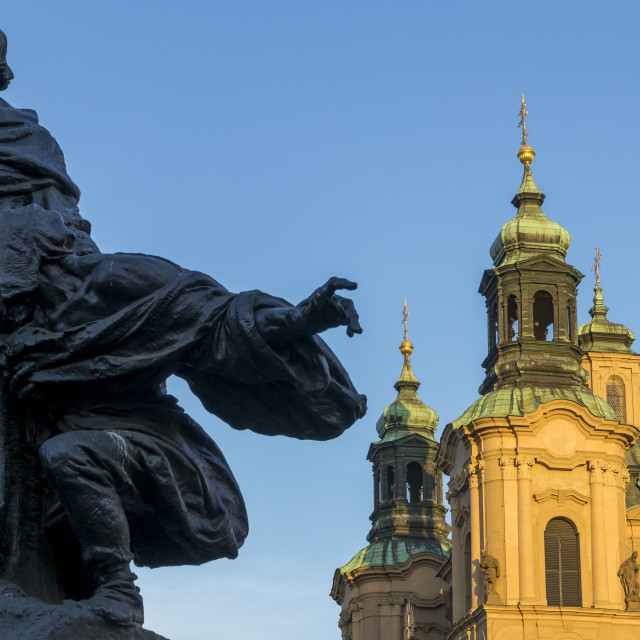 """Jan Hus Monument and St. Nicholas' Church seen from the old town market..."" stock image"