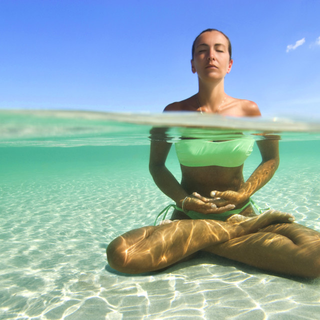 """Woman doing yoga in the Caribbean sea."" stock image"