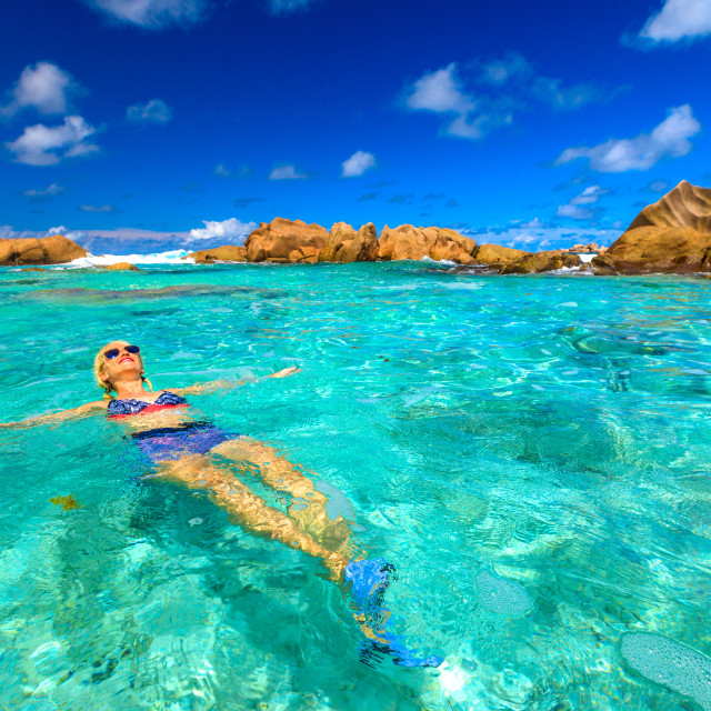 """Swimming pool at Anse Cocos in La Digue. Happy woman in bikini lying on..."" stock image"