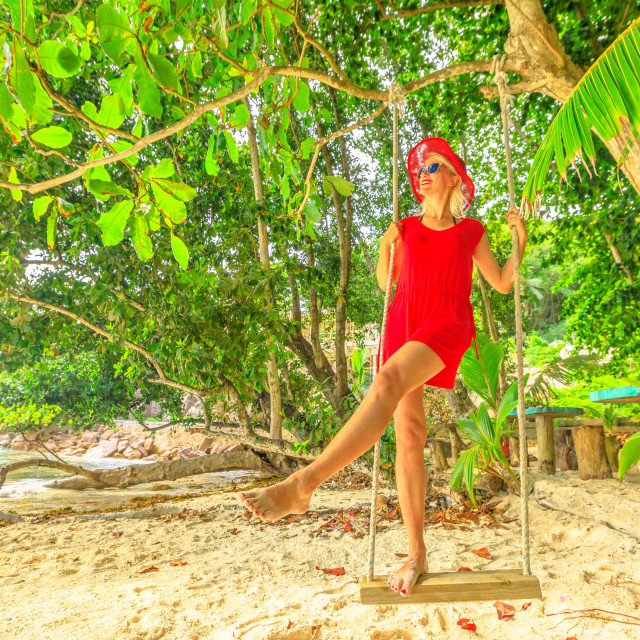 """""""Summer vacation concept. Happy lifestyle tourist woman in red dress swinging..."""" stock image"""