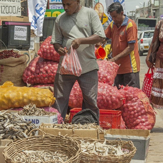 """People at grocery stall on street in Trincomalee, Sri Lanka"" stock image"