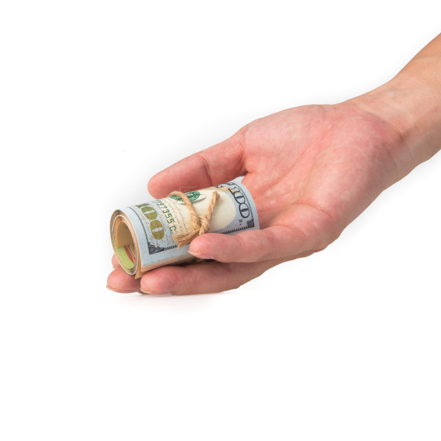 """hand holding a roll of 100 usd"" stock image"