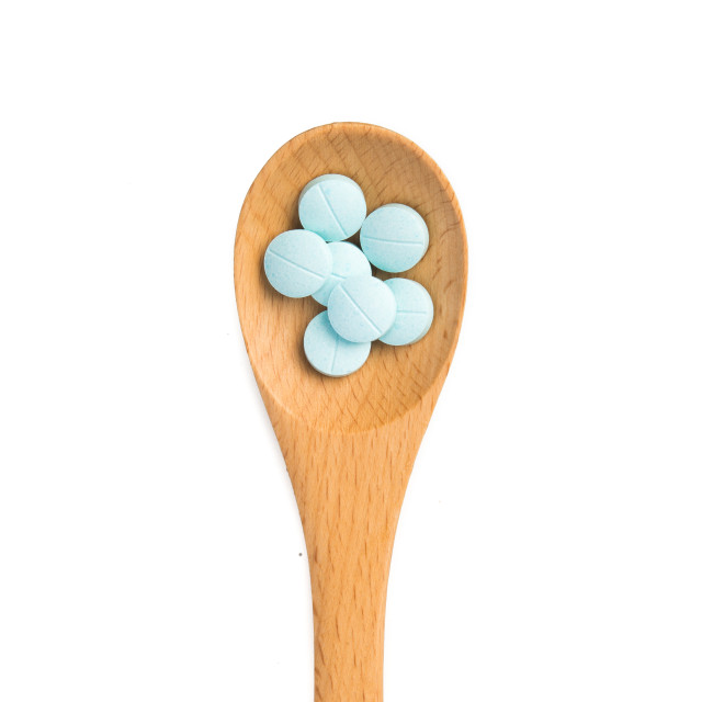 """pills in wooden spoon"" stock image"