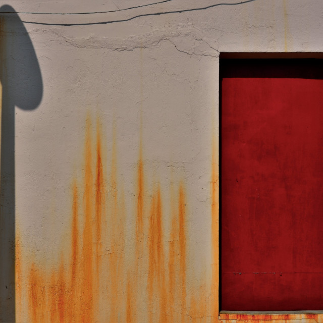 """Red Door and Shadows"" stock image"
