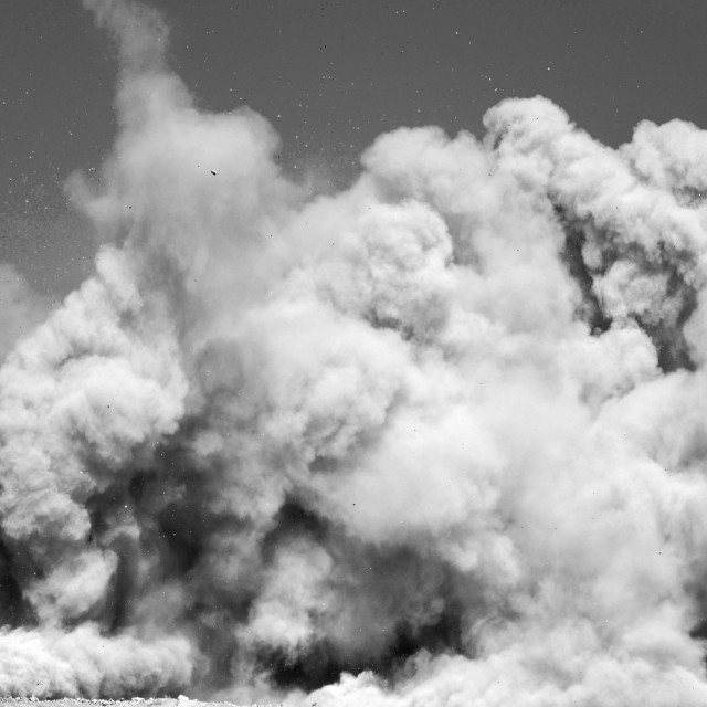 """""""Large clouds and rock particle after the blast"""" stock image"""