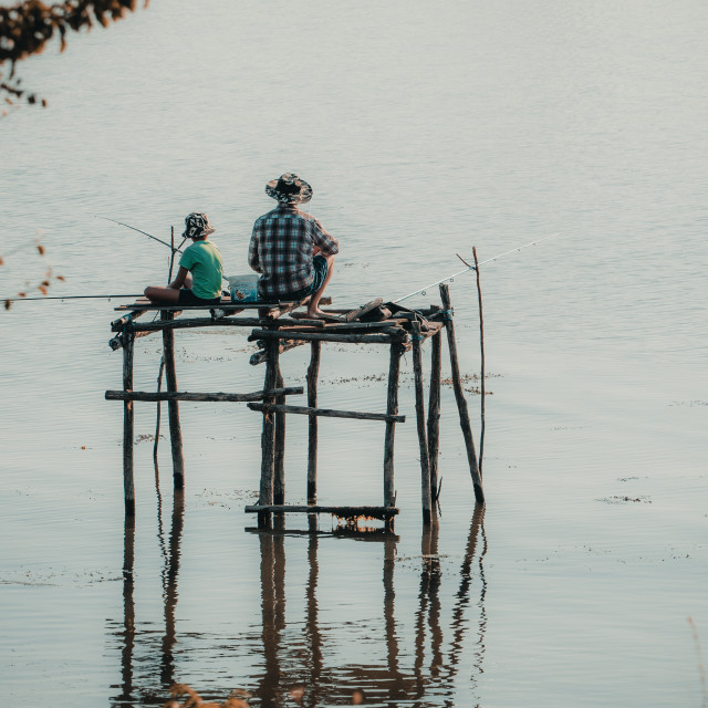 """Father and son fishing together"" stock image"
