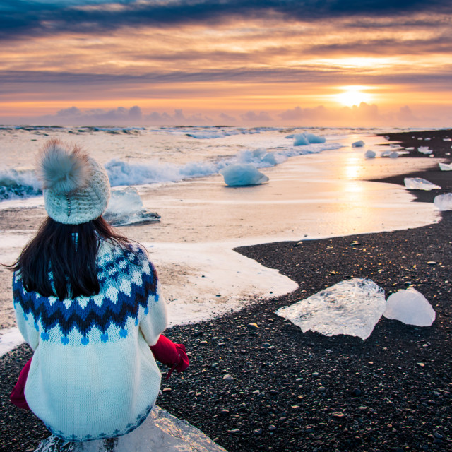 """Woman enjoying Diamond beach sunset in Iceland"" stock image"