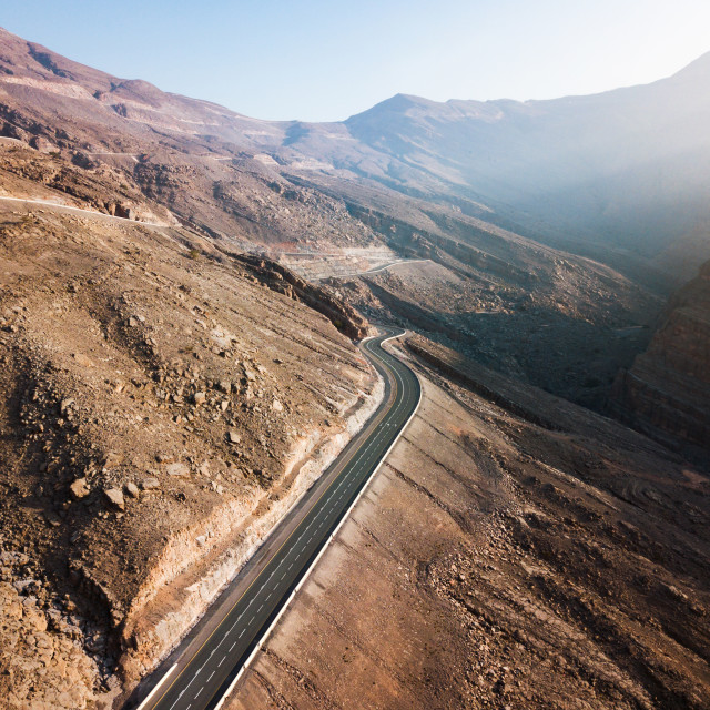"""Desert mountain road in the UAE aerial view"" stock image"