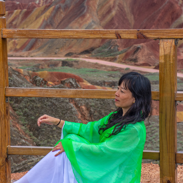 """""""Woman and the colourful mountains"""" stock image"""