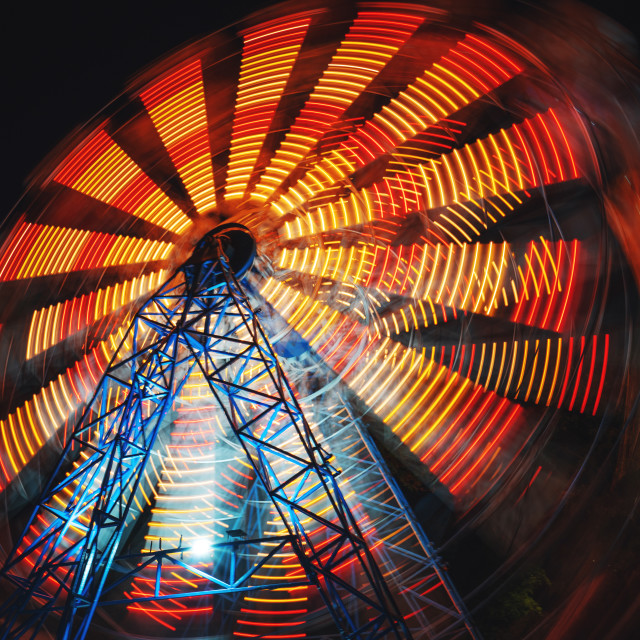 """Ferris Wheel at county fair at night, motion blurred"" stock image"