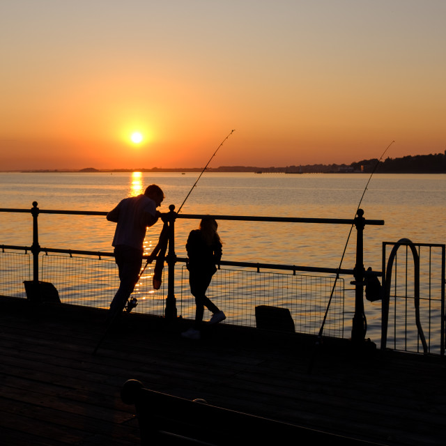 """Fishing Off Ha'penny Pier Harwich"" stock image"