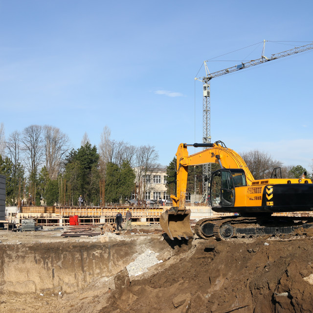 """""""excavator and workers on construction site"""" stock image"""