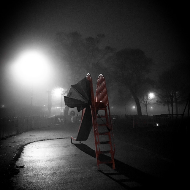 """""""Abandoned Slide in the Night sky"""" stock image"""