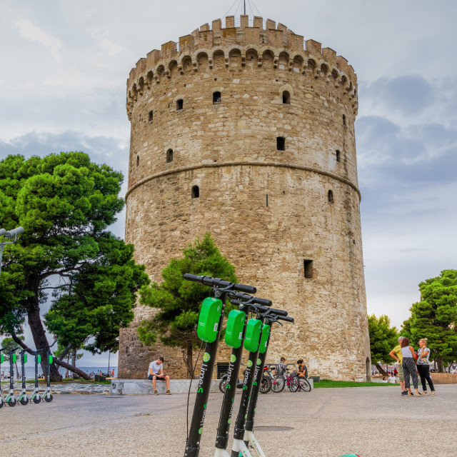 """""""Thessaloniki, Greece Parked Lime electric Scooter rentals without passenger."""" stock image"""