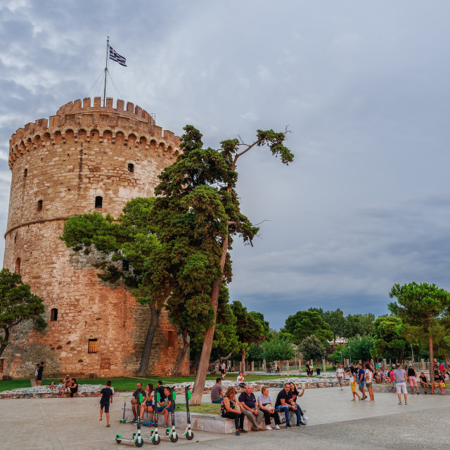 """""""Thessaloniki, Greece Golden hour at the city landmark with crowd & Lime-S electric scooters."""" stock image"""