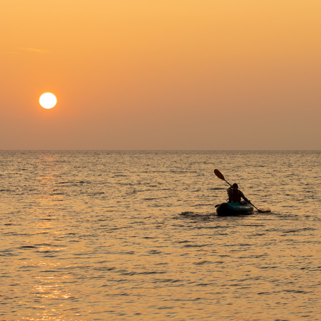 """Kayaking into sunset"" stock image"