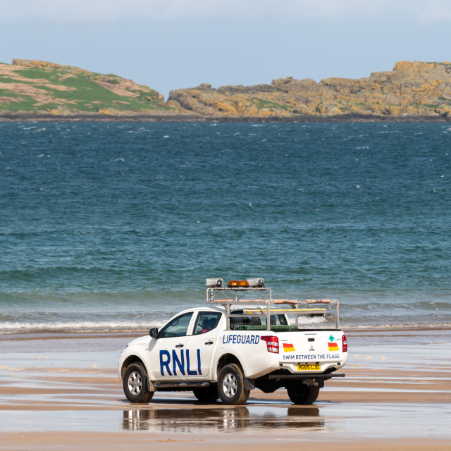 """RNLI vehicle on the shore"" stock image"