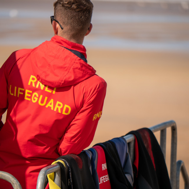 """RNLI Lifeguard at Portrush, Northern Ireland"" stock image"